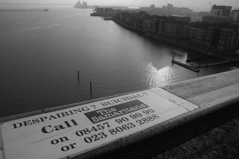 Close-up+of+a+British+suicide+prevention+hotline+number+on+the+ledge+of+Itchen+Bridge+in+Southampton%2C+Hampshire