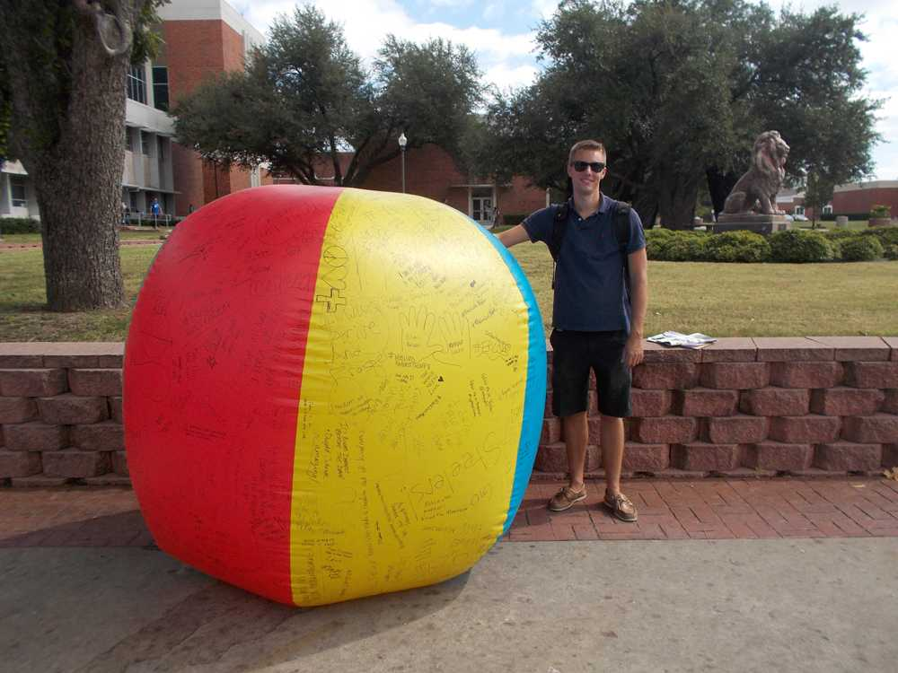 Jonathan Narramore represents Turning Point USA with the giant beach ball scrawled with writing.