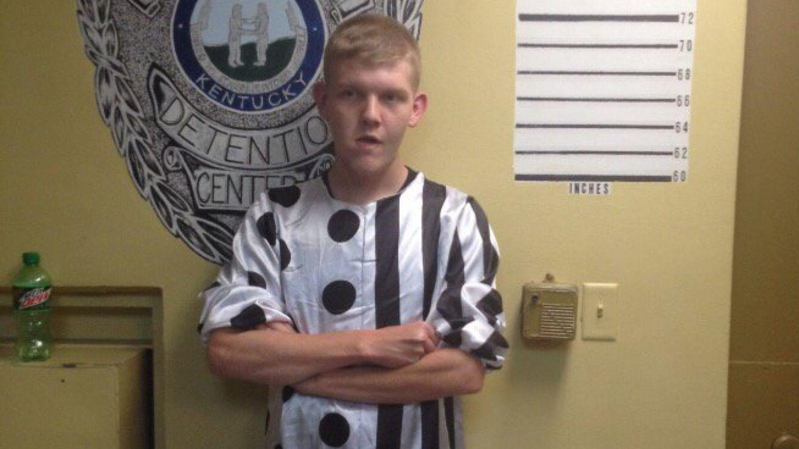 """Jonathan Martin, aged 20, was arrested for """"allegedly causing public alarm"""" in his clown costume."""
