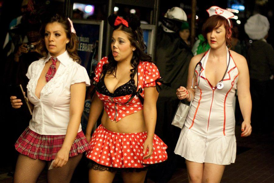 Young+women+sporting+skimpy+schoolgirl%2C+Minnie+Mouse+and+nurse+costumes