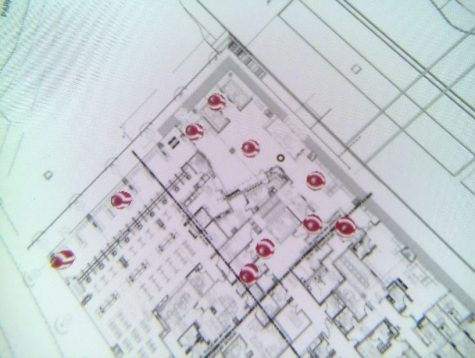 A floor plan with red photospheres