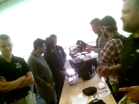 Blake Potts shows a pair of virtual reality goggles.