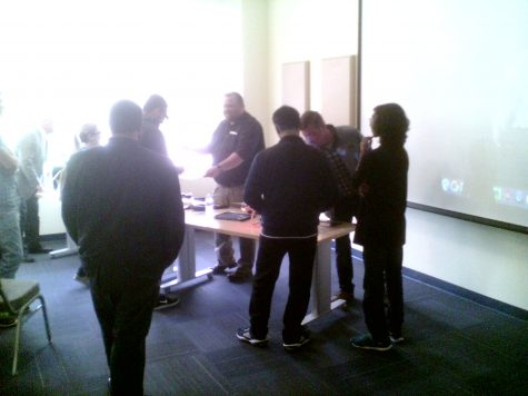 Students gathered around the display table.