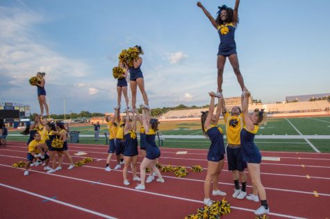 The Lion Cheerleaders whip up excitement as they perform.