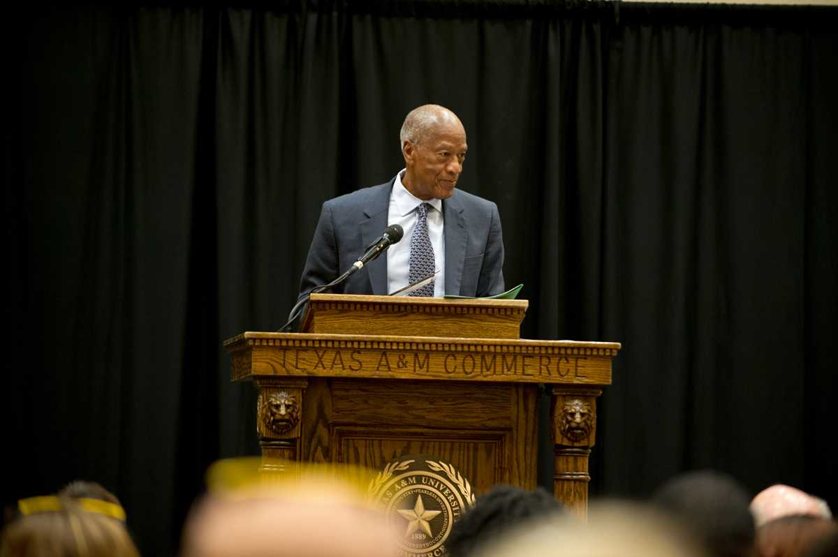 Robert L. Green speaks to the crowd in the Rayburn Student Center.