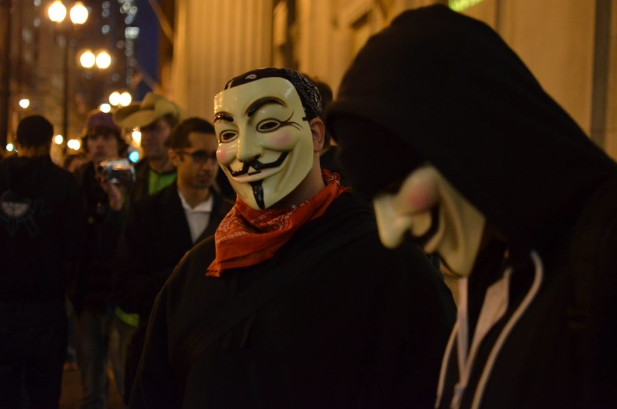 Occupy+Chicago+protesters+wearing+Guy+Fawkes+masks%2C+a+symbol+associated+with+the+%22hacktivist%22+group+Anonymous.