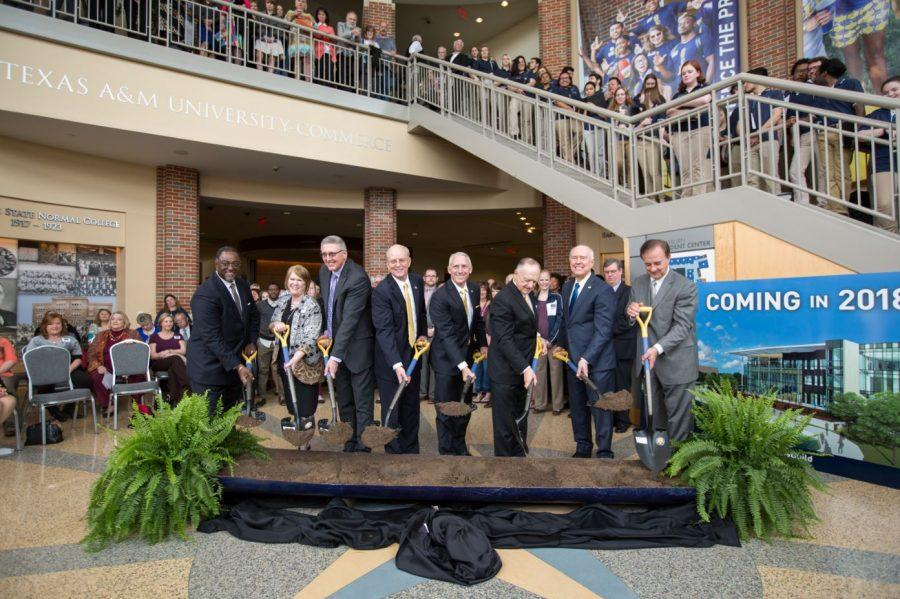 Administrators symbolically break ground for the Nursing Building including Chancellor Sharp (far right), President Keck (second from the right), and State Rep. Dan Flynn (third from the right).