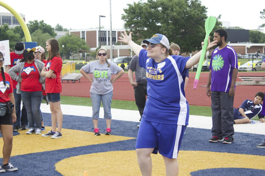 Competitor Gabby Smith celebrates after winning the javelin throw contest.
