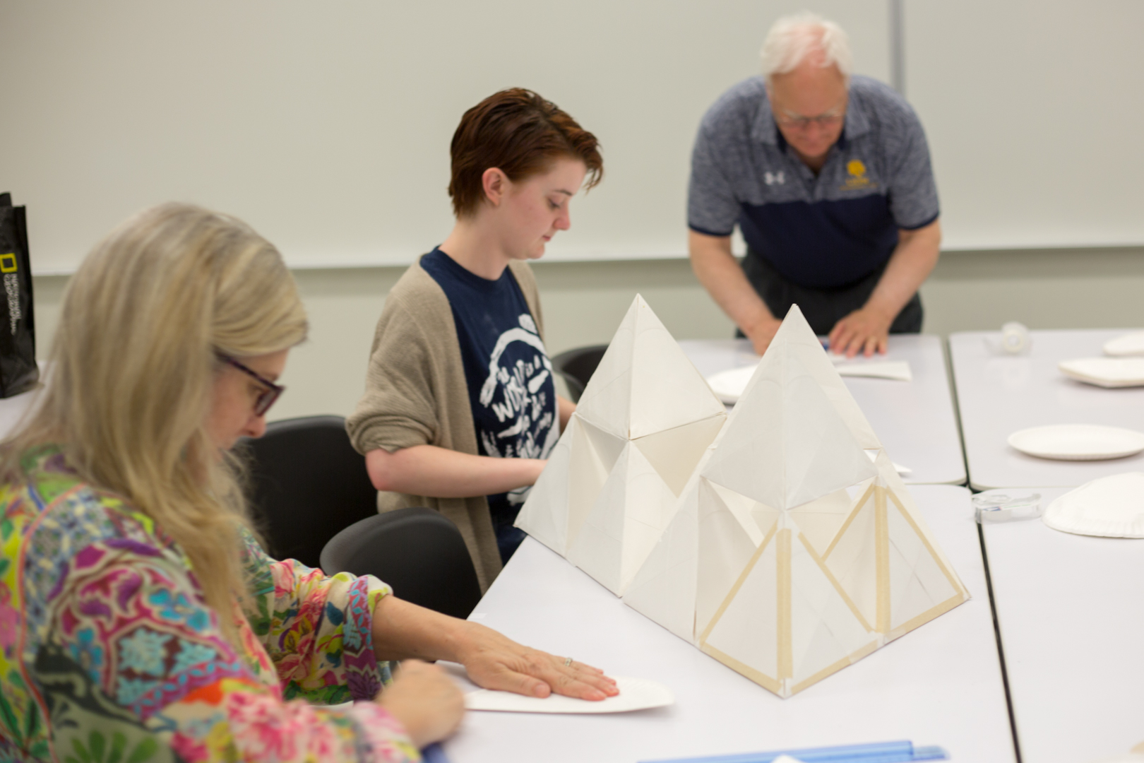 The+Paper+Plate+Sculpture+Workshop%2C+led+by+Wyman+Williams+%28back%29%2C+had+participants+fold+paper+plates+to+form+different+shapes+or+to+combine+these+shapes+into+a+sculpture.
