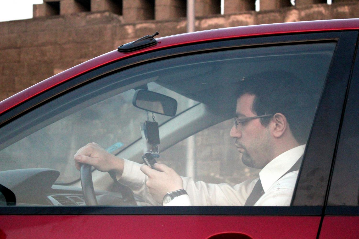 Man texting while at the wheel. Photo Credit/ ~W~ via Flickr