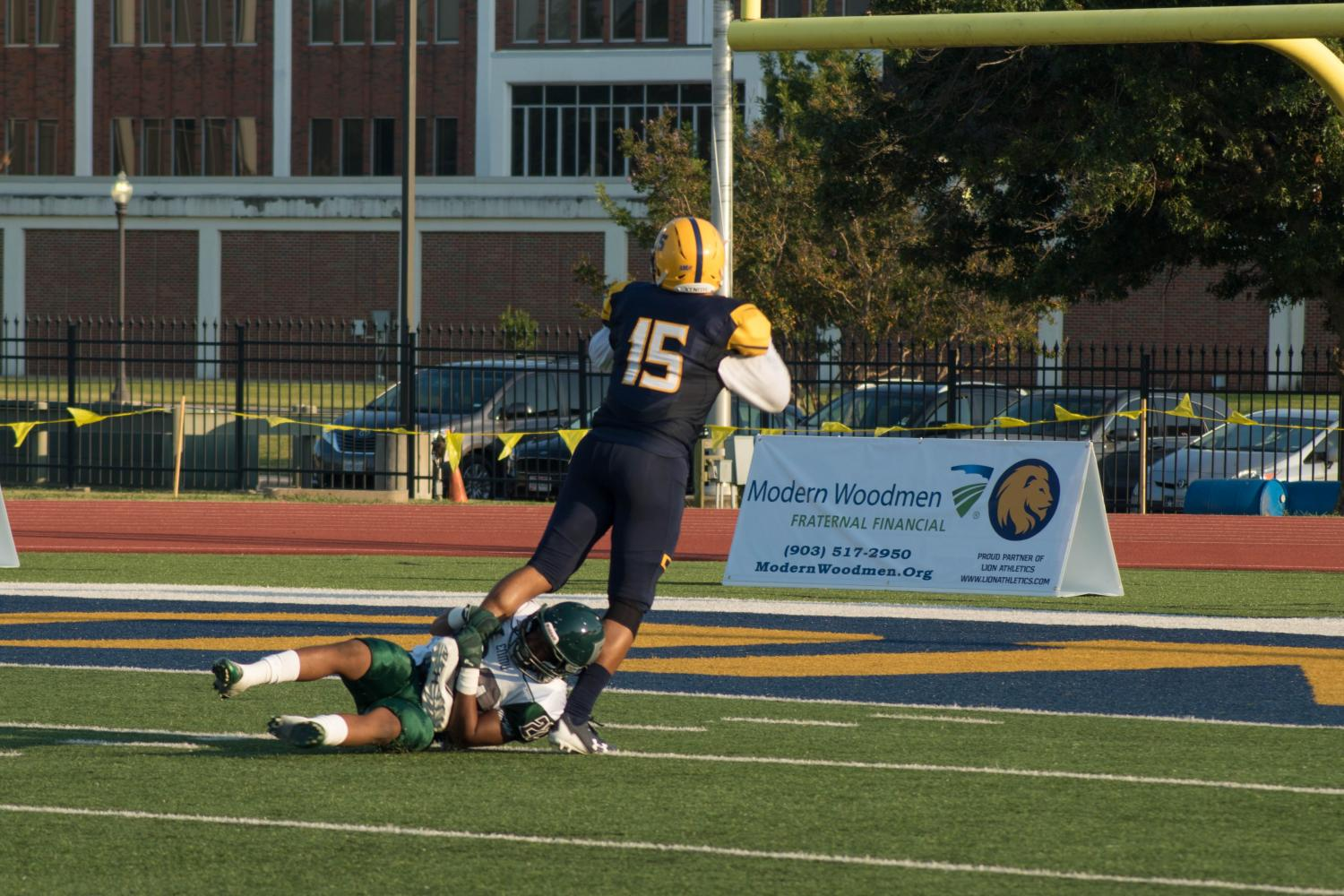 Vincent Hobbs fights off a tackler to score a touchdown