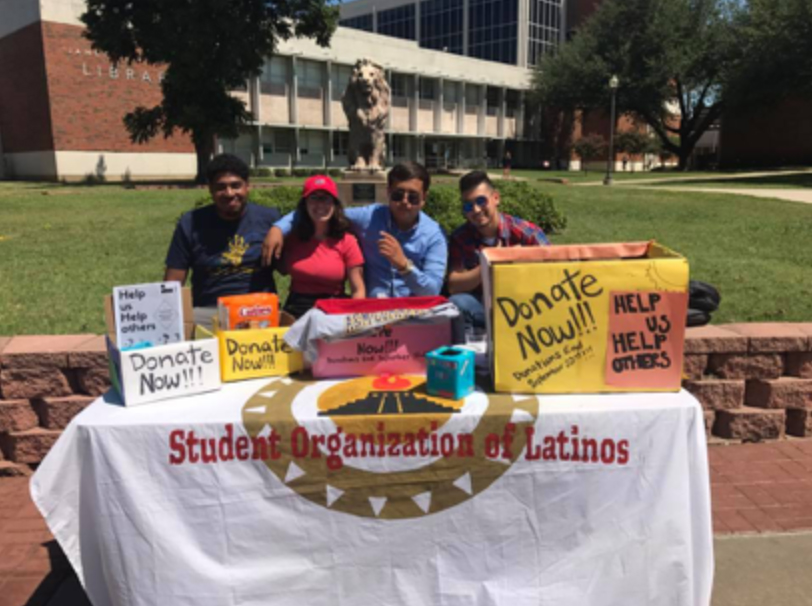SOL+members+stand+outside+James+Gee+Library+collecting+donations+for+those+affected+by+Hurricane+Harvey.+Courtesy%2F+Student+Organization+of+Latinos