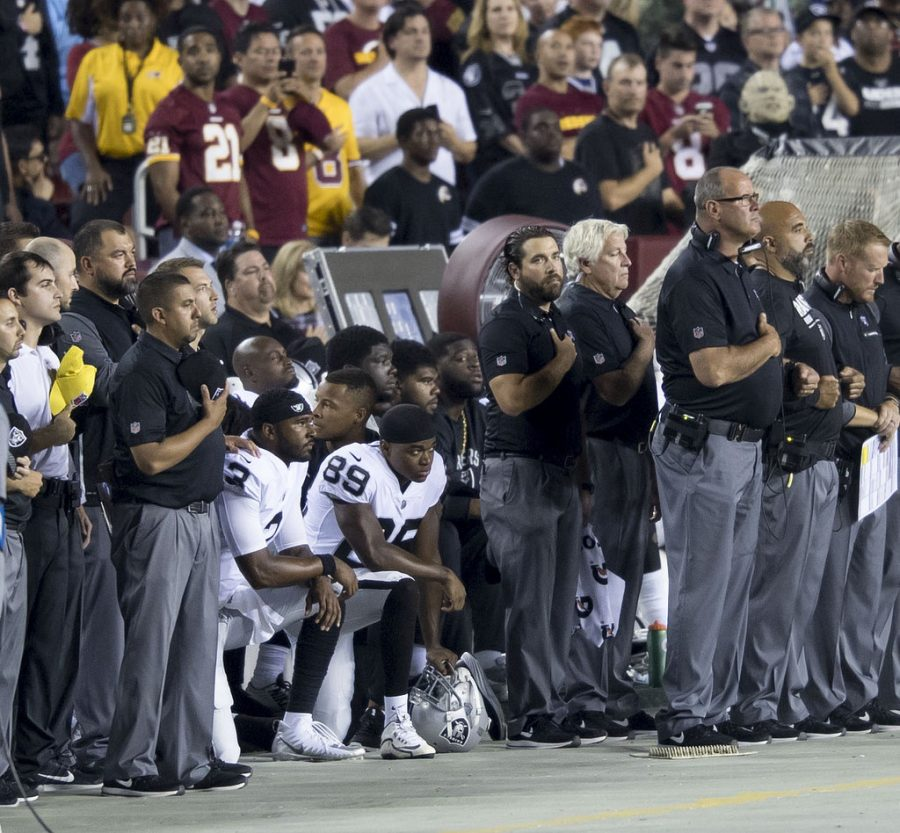 Oakland+Raiders+teammates+kneel+during+the+national+anthem+before+a+game+against+the+Washington+Redskins+at+FedExField+on+September+24%2C+2017+in+Landover%2C+Maryland.+Photo+Courtesy+%7C+Keith+Allison