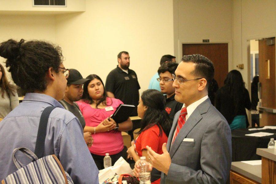 Immigration Lawyer Felix Villalobos from Raices talks to SGA senator Brayan Dicante.