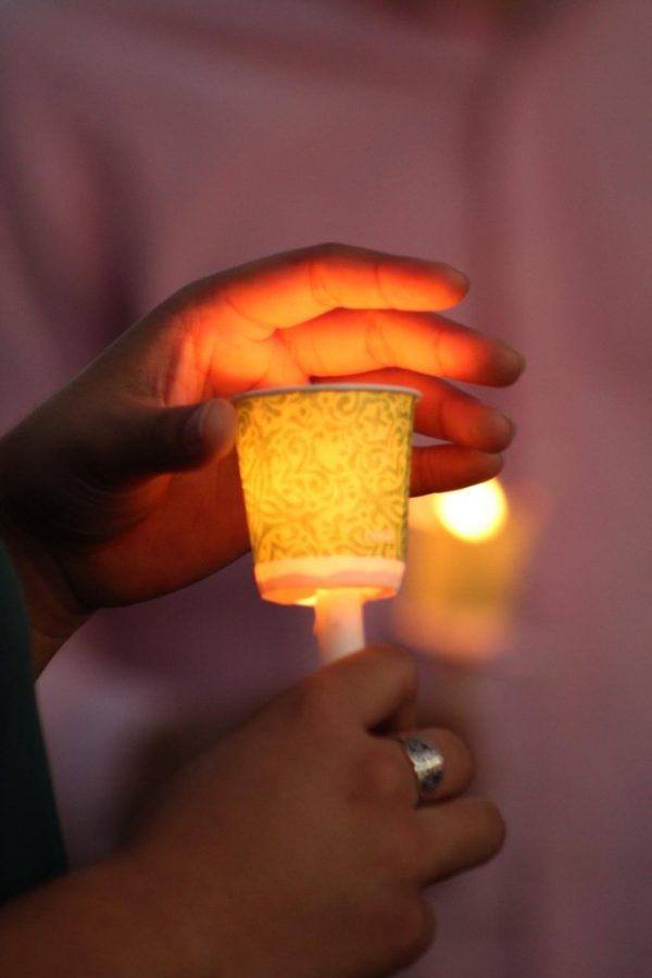 Candles glowed in the darkness as they were lit.