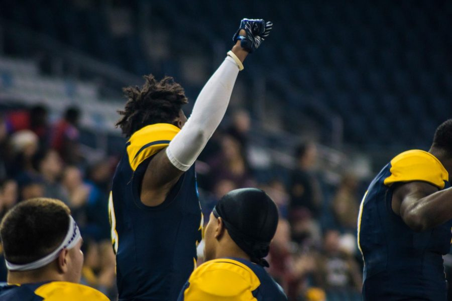 A Lions player holds his fist in the air to express his emotion during the tension-filled game.