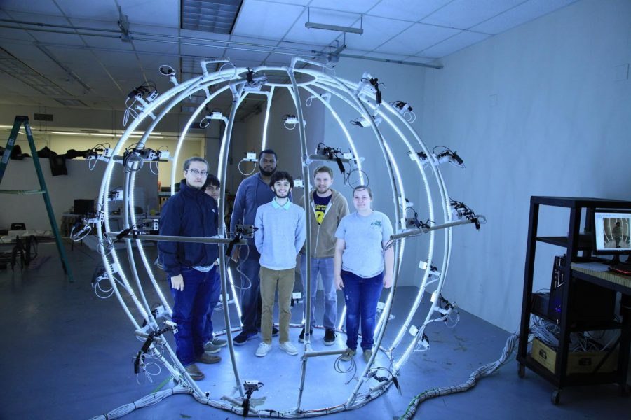 From left to right: Michael Apodaca, Stephen Gonzales, Devin Lewis, William Schlesinger, Derek Walker, and Haley Ferguson pose inside their 3-D scanner. Photo Courtesy | Joseph Daun