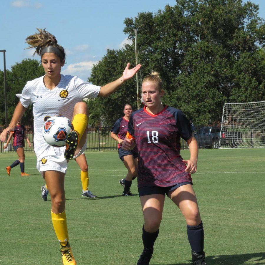 Sabrina Munguia kicks the ball against Metro State. Photo Courtesy | John Parsons