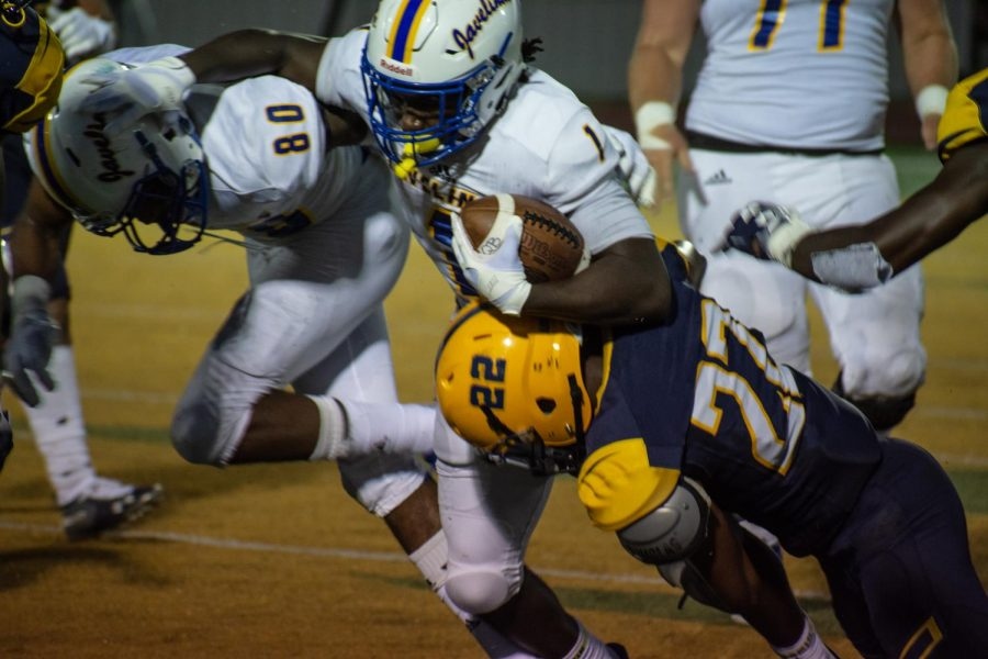 Lion defensive back Darent White tackles Javelina running back Jeff Carr. White would make six total tackles while Carr rush for 33 yards on 9 attempts. Photo Courtesy | Jessie Cunningham