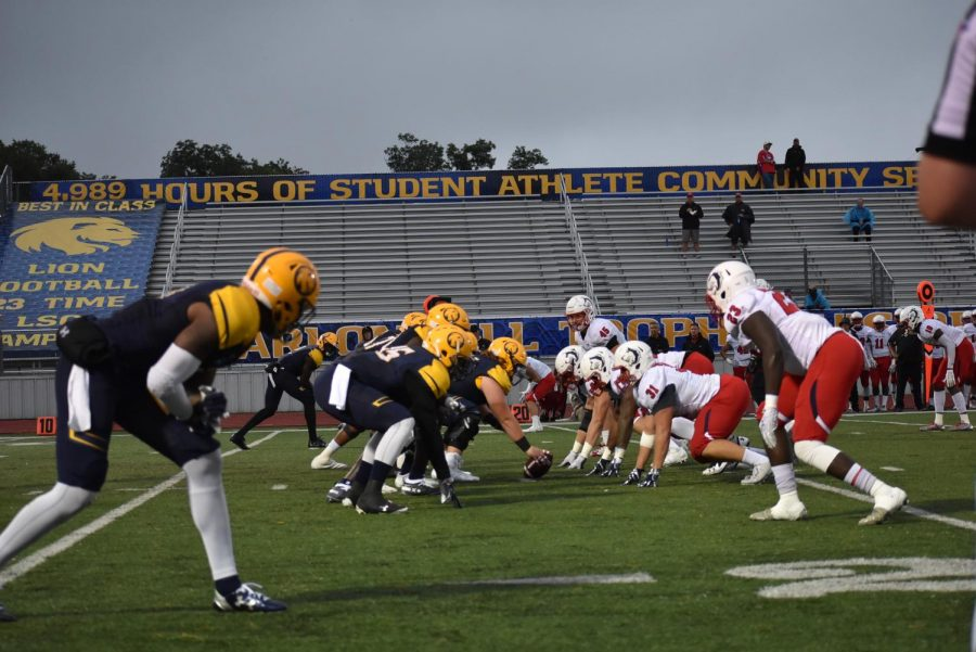 The Lions offense readies to clash against the Thunderwolves defense. Photo Courtesy | Ashley Tuppen