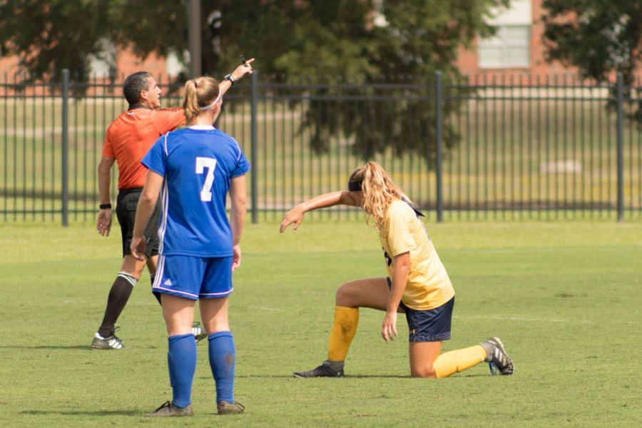 Cora Welch wipes away some sweat during a stoppage in play | Photo by Joseph Miller