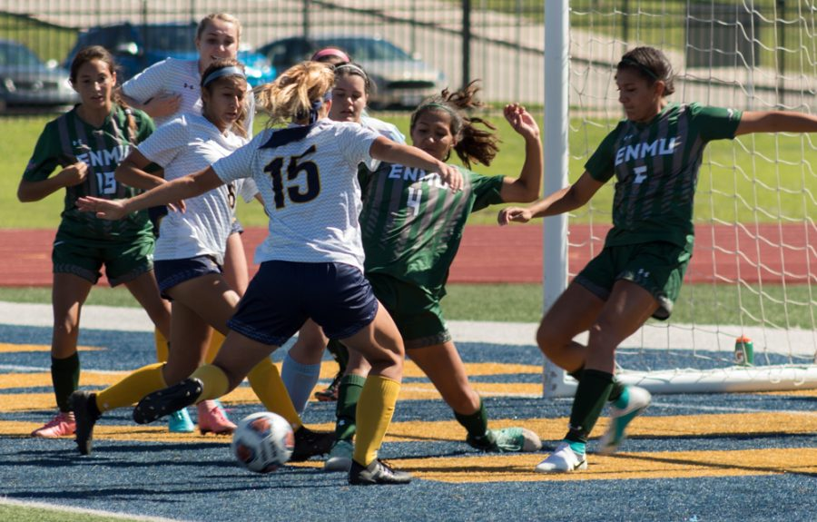 Cora Welch attempts a shot in the box against ENMU | Photo by Joseph Miller
