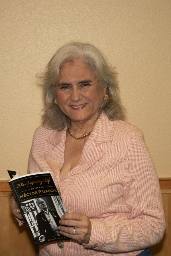 Cecilia Garcia-Akers holds her book