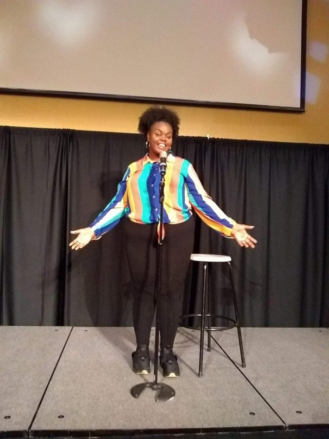 Ashlee Haze performing Shake What the Motherland Gave You at the Poetry Slam.