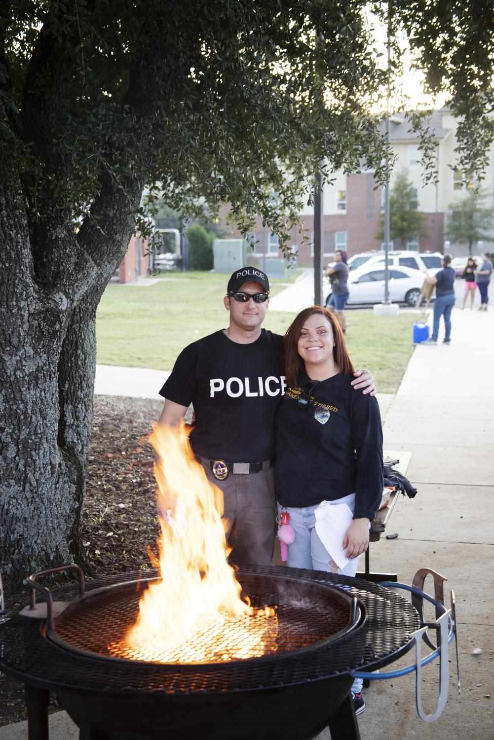 Grillmasters+of+the+night+UPD+Asst.+Chief+of+Police+Kyle+Lowe+and+intern+Dacia+McDuffie+pose+for+a+picture.+East+Texan+Photo+%7C+John+Parsons+