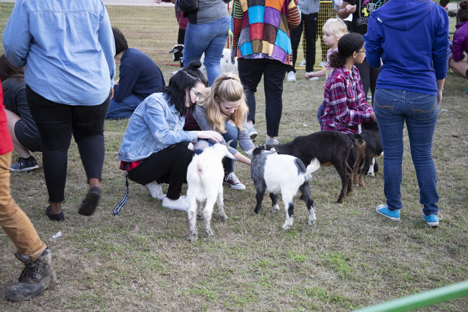 Students+interact+with+the+goats+at+the+petting+zoo.+East+Texan+Photo+%7C+John+Parsons+