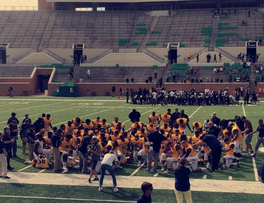 Lion players kneel in prayer following the win over MSU-Texas | Photo Courtesy Abigail Rogers