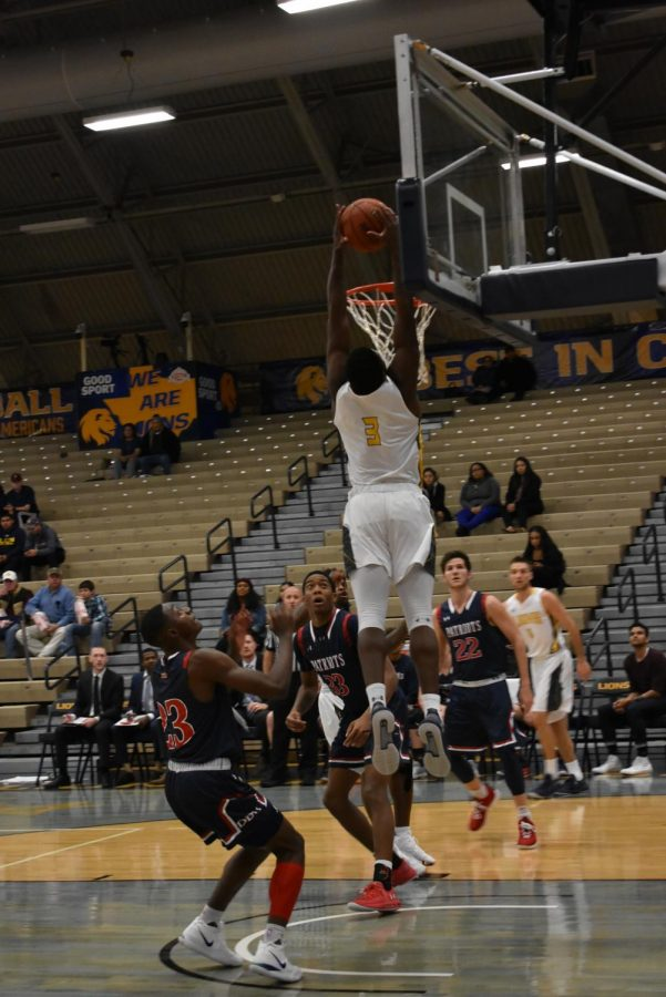 Tyree Robinson dunks the ball in a 83-61 victory over the Dallas Baptist Patriots   Photo by Ashley Tuppen
