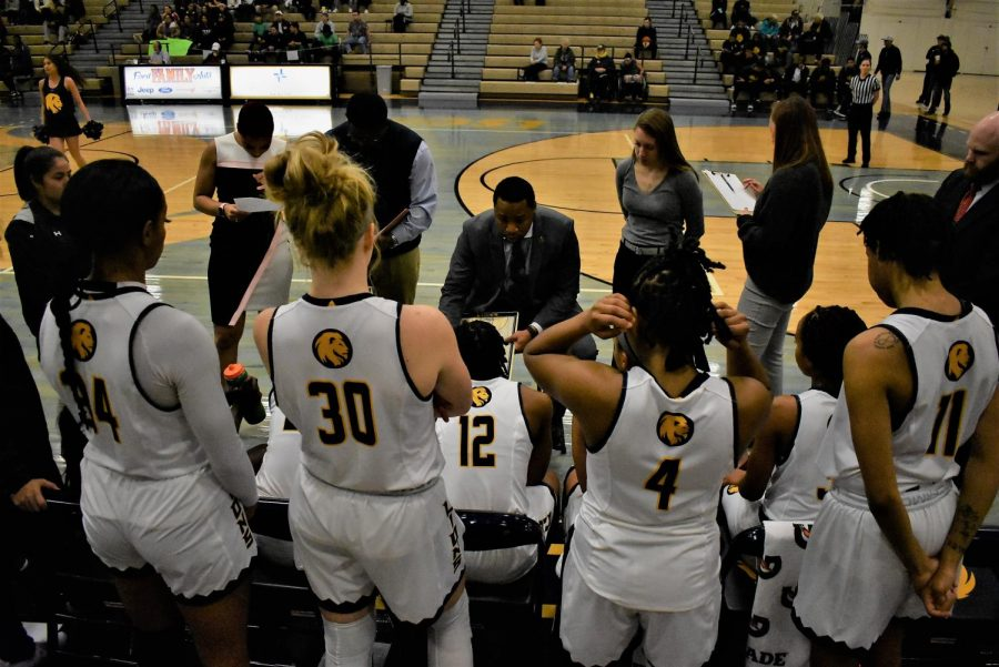 The Lions huddle up with Coach Burton during a timeout | Ashley Tuppen