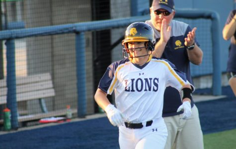 Jodie Hill is all smiles after hitting a home run in game 2 | Joseph Miller