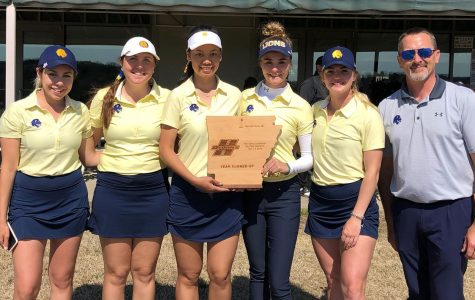 The women's squad with their runner-up trophy at Henderson State | Lion Athletics