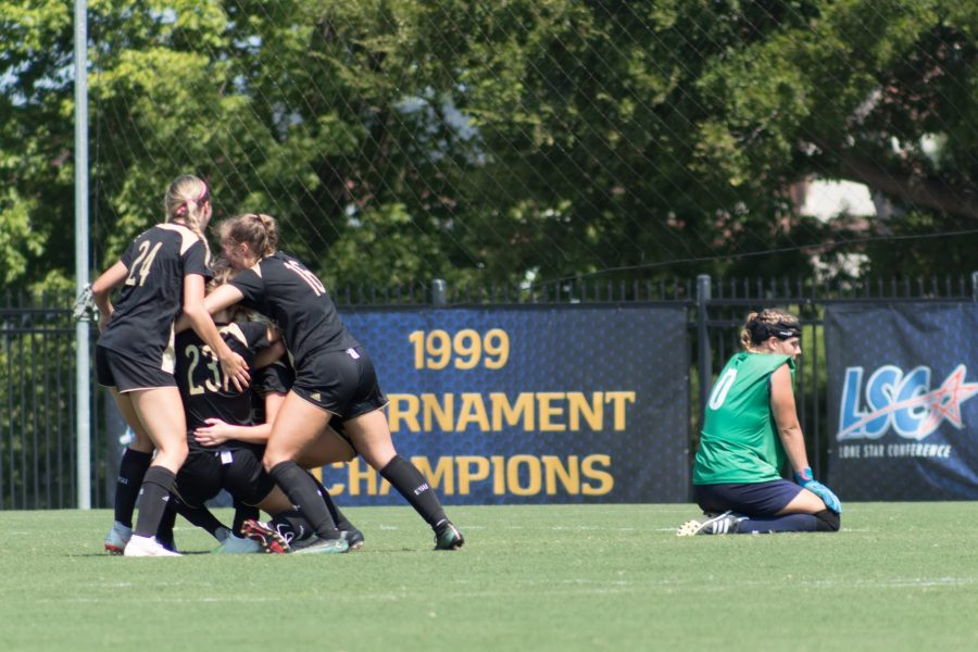 Lions GK Jen Peters looks away as Emporia State celebrates their overtime game-winning goal.