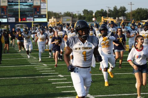 L.A. Dawson leads the Lions onto the field in the season opener against Selección Nuevo León | Photo by John Parsons