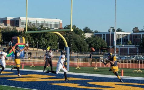 Tight End Tyler Guice catches a touchdown from Miklo Smalls on Senior Day | Photo by Bri Jolley