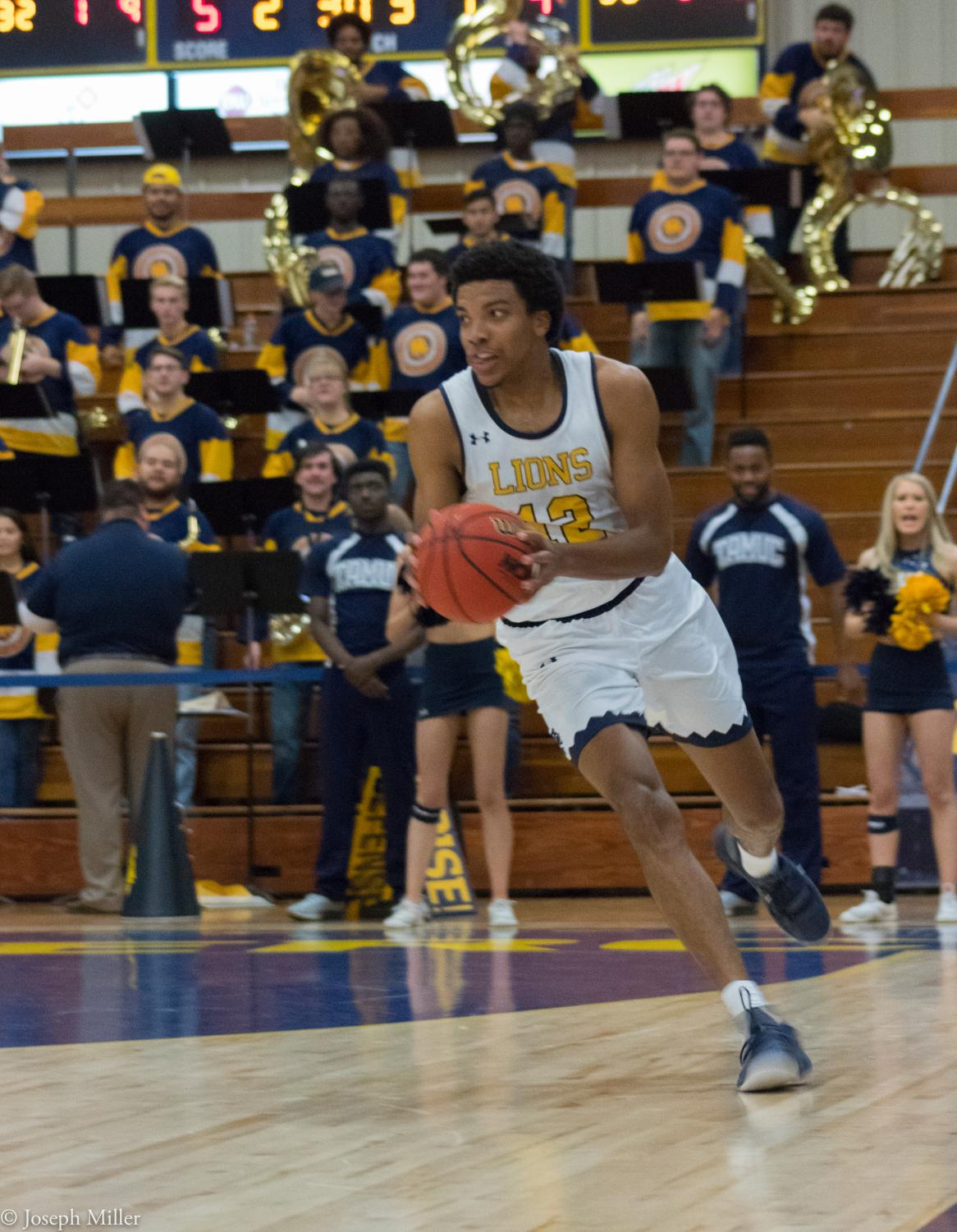 Wayne Stewart pushes the ball up the court