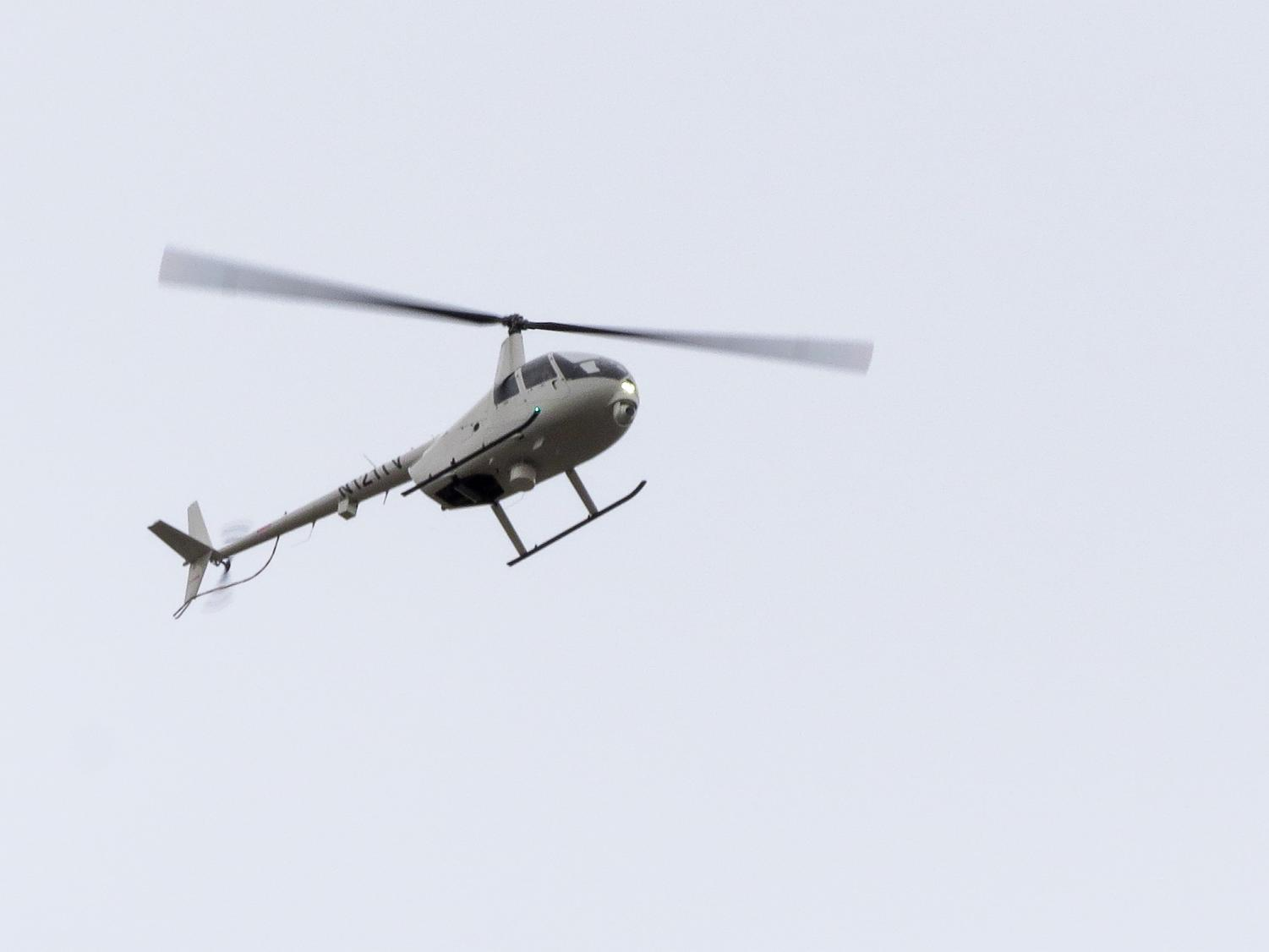 A helicopter hovers over the Texas A&M University-Commerce campus while university police investigate a shooting with one person injured and transported to the hospital and two people dead.  Photo by Jo