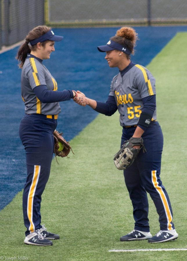 Uxua+Modrego+%28left%29+and+Ta%27lyn+Moody+%28right%29+share+a+handshake+during+player+introductions.