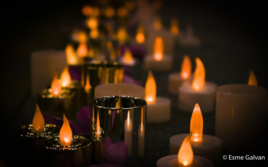 Tea light candles light up the stage in memory of Deja Matts.
