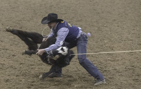 Carson Hicks competes in tie down calf roping