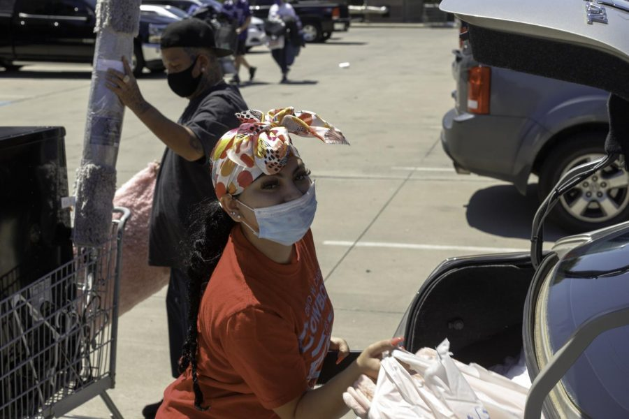 Alize Espinoza, sophmore Business major, unpacks her belongings with help from her dad, Juan Espinoza, of Los Angeles