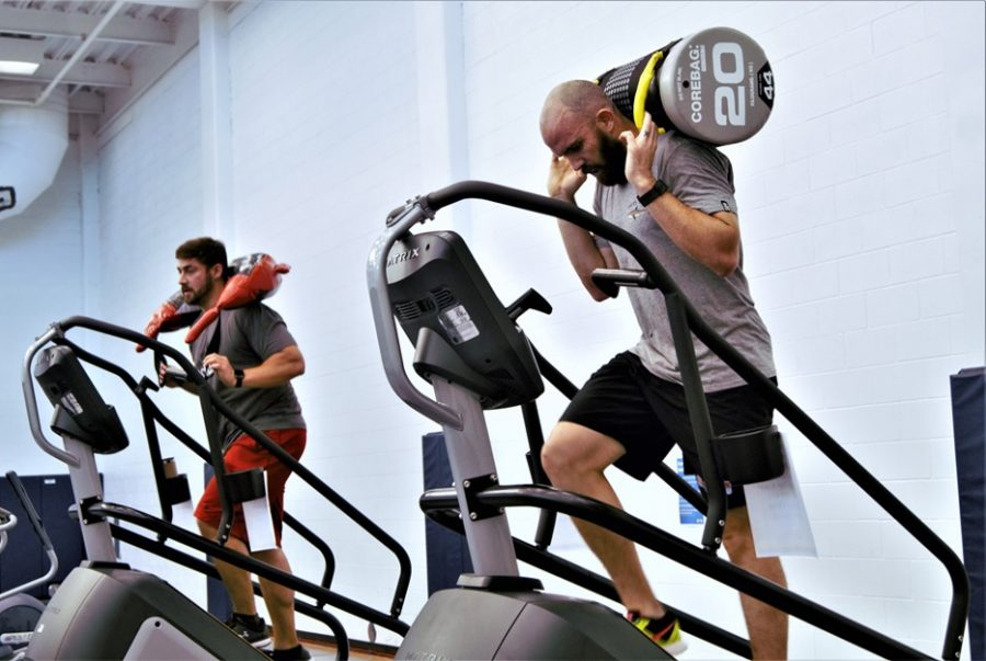 Dan Semprini, fitness director, and Kellon Dion, coordinator for Outdoor Adventure, tackle the challenge to climb 110 floors