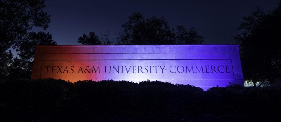 The main entrance to campus is lit up red, white and blue in honor of Veterans Day.