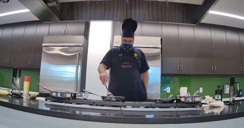 Dr. Rudin prepares to flip a flour tortilla in the kitchen.