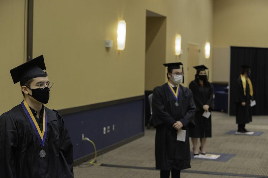 Students wait to walk the stage to become graduates of Texas A&M University-Commerce
