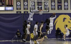 Dante Adams goes high to grab one of his seven rebounds