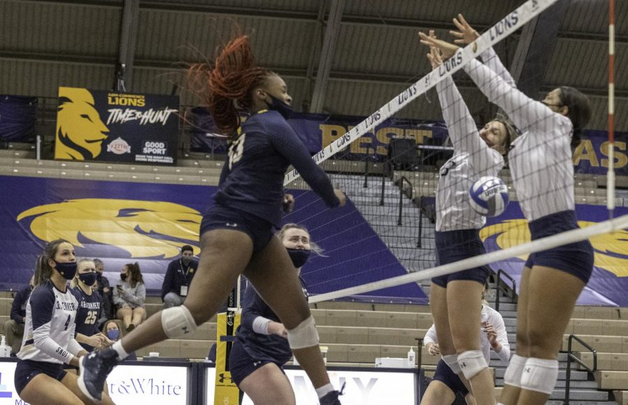 Maiya Dickie hits the ball for one of her career high 15 kills.